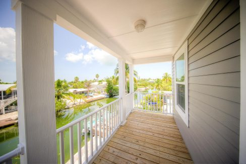 45 Palm Drive, Saddlebunch, FL 33040, Brand new 3BR/3BA modular home elevated & overlooking direct canal access!