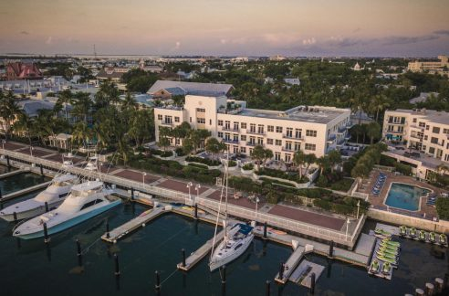 Just steps from Duval Street & the Key West Seaport, you can find this adorable 2 BD/2 BA condo in Harbour Place at the lovely Truman Annex neighborhood.
