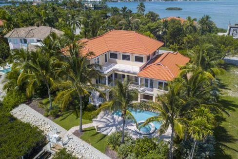 Enjoy Keys living in this impeccable 3BR/4BA Shark Key home with spectacular Gulf views & a relaxed setting