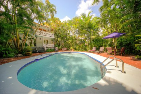This Transiently licensed 4 Bedroom/ 4 Bath Eyebrow Conch House, with 2,252 sq. ft. of living space