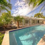 Enjoy complete privacy behind this totally walled and newly renovated home.