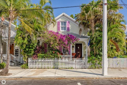 On a famed street spanning the heart of Old Town Key West sits this quintessential 3BD/3BA Key West conch house.