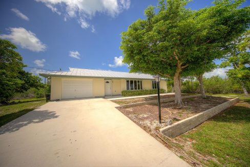 In pristine shape, with tile floors & updated appliances it has a wonderful Florida room with glass doors opening on to a patio